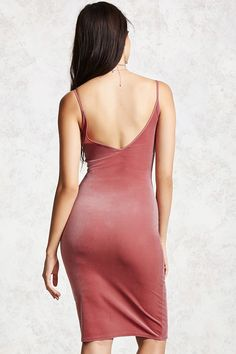 Style Deals - A smooth velvet cami dress featuring a scoop neckline and a V-cut back.