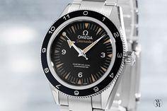 "The  Omega Seamaster ""Spectre"" is equipped with a stainless steal case, powered by a co-axial Calibre 8400 and is resistant to a magnetic field of up to 1500 Gauss."