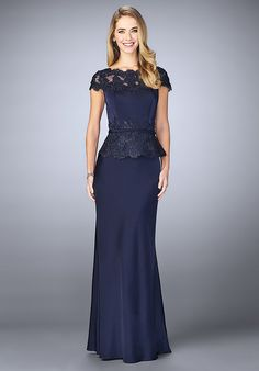 Graceful jersey gown with sheer neckline and thin belt at the waist. The dress features beaded embroidery on the neckline and peplum. Back zipper closure. Evening Size Chart B.