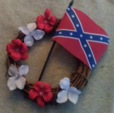 8 inch grapevine wreath decorated with silk flowers and miniature Confederate flag Confederate Memorial Day, Confederate Flag, Flag Wreath, Grapevine Wreath, Holiday Wreaths, Silk Flowers, 4th Of July Wreath, Grape Vines, Miniatures