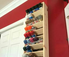 Vertical spray paint cans display
