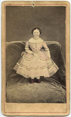 1870s CDV of smiling China head doll, on the back of photo: Mr. & Mrs. Cornell, Waterloo, New York