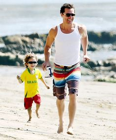 Levi McConaughey rocks sporty shades while chasing his famous dad at the beach