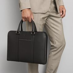 Made in Italy with full-grain, vegetable-tanned leather. A contemporary briefcase acting as a personal portfolio; an everyday companion for the modern gentleman. Black Handbags, Purses And Handbags, Leather Handbags, Leather Laptop Bag, Leather Briefcase, Rimowa Luggage, Designer Suits For Men, Briefcase For Men, Mens Style Guide