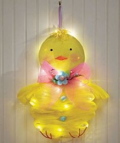 "Adorable Lighted Easter Chick Peep Cordless Battery Operated Mesh Door Wall Hanger Decor Springtime Lights up Whimsical Cute Door Wreath  Over 1-1/2 feet tall!  Chick, 18-1/2"" x 16"" x 3""  Polyester, foam and metal  Requires 3 ""AA"" batteries"