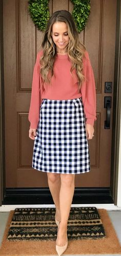 #winter #outfits red long-sleeve shirt and black skirt