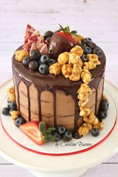 Chocolate mud cake with dark chocolate ganache drizzle, topped with caramel popcorn, strawberries, blueberries and white chocolate/raspberry shards.