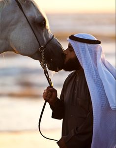 Sheikh Mishary Al Afasy and his Stallion. He has the most amazing voice for reciting the Quran!