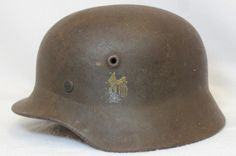Lot 195: WORLD WAR II NAZI GERMAN MILITARY HELMET XW - ACCURATE ESTATE AUCTIONS & APPRAISALS | AuctionZip