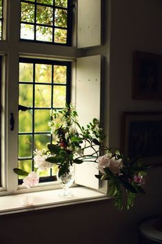 Country Cottage Style window with crystal vase and wild roses