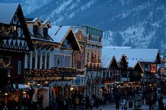 small mountain town in snow and Christmas lights