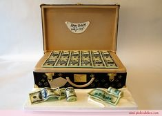 It started with our money barrel cake and $50 dollar bills. This birthday briefcase cake ups the ante with $100 bills. The flavors included red velvet cake