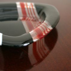 Fused glass dish coin candy bowl, Black and red triangle.. $38.00, via Etsy.
