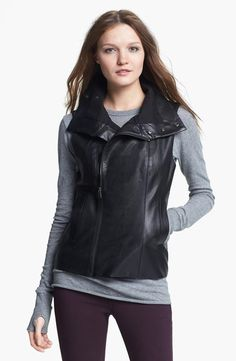 Add some edge with a faux leather vest.