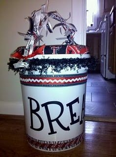 I did something very similar to this at our last banquet - got amazing buckets over at Hobby Lobby with each girls initial!  Too cool! and the girls loved it!!!