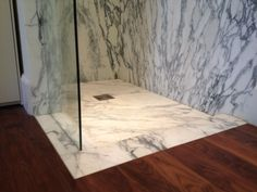 Marble Bathroom designed by Fred Collin, architect North Yorkshire. Material Arabascato Marble, book matched on the walls with a textured custom shower tray.