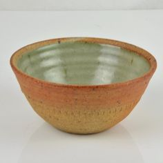 A thrown stoneware bowl with a wood ash glaze on the interior and un-glazed on the exterior. Diameter: 15cm. If purchasing from outside the UK, please contact u