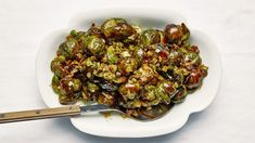 These roasted whole brussels sprouts get so crispy on the outside you'll worry they're burnt (they're not! Inside though, they're perfectly, deliciously mushy—which, according to us, isn't a bad thing. Thanksgiving Sides, Thanksgiving Recipes, Lime Recipes, Fun Recipes, Recipies, Pasta Recipes, Gourmet Recipes, Dinner Recipes, Salads