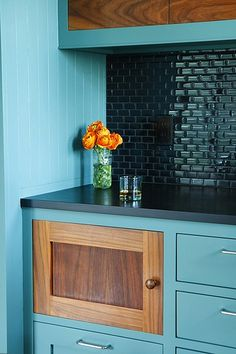 Dark Blue-Green back splash + brighter blue + timber cabinet doors