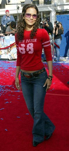 Halle Berry repping her Von Dutch shirt, purple-tinted sunglasses, and flared jeans. | 60 Pictures That Perfectly Capture The 2000s