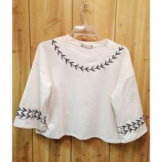 Cute embroidered top -Size small -NWT -Color: white with black embroidery *Please disregard black speck visible in some photos, it is a defect of my camera not the item pictured, thanks!! * Boutique Tops Crop Tops