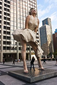 "Marilyn Monroe Statue in Chicago The movie ""Seven Year Itch"" was filmed in NYC, but the statue of Marilyn Monroe is in Chicago. It's located in front of the Chicago Tribune. Chicago Vacation, Chicago Travel, Chicago Trip, Travel Portland, Chicago Street, Travel City, Marilyn Monroe, My Kind Of Town, Norma Jeane"