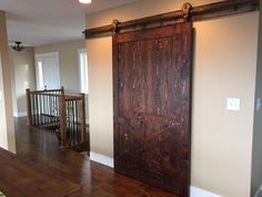 Rustic interior sliding barn doors are the new rave in modern rustic design. This picture is an example of the reason why. Shown here in our Mountain Collection, Glacier color. From Sustainable Lumber Co.