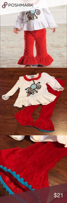 Mud Pie Baby Monkey 2 Piece Outift Mud Pie Baby Monkey 2 Piece Outift Size 2t-3t.  Worn and washed once and in like new condition top has lots of stretch to it as so the elastic waistband of pants. Pants are a red minky fabric with blue trim.  No stains or tears  No trades and no PayPal mudpie baby Matching Sets