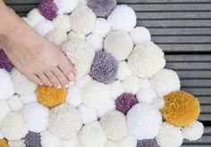 Pom Poms are a great versatile material to work with, and with the winter nights coming every closer, what could make your room more cosy than a fluffy pom pom rug? Check out this tutorial to find out how.