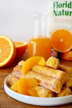 French Toast Roll-Ups with Orange Syrup #recipe from justataste.com | Ditch the forks in favor of your fingers with this quick and easy recipe for French Toast Roll-Ups with Orange Syrup! #breakfast