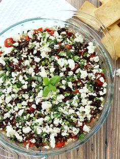 This Ultimate Greek 7 Layer Dip is a tasty and fresh Mediterranean version on the classic Mexican dip. Greek yogurt, hummus, veggies and of course Feta cheese.