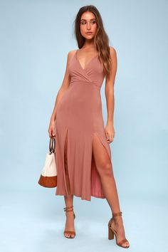 Take the Time to Tango Blush Pink Midi Dress out for a twirl! Jersey knit midi dress with surplice bodice, and midi skirt with twin slits at front.