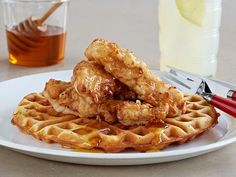 Chicken and Waffles : A topping of fried chicken might be the only way to improve upon our classic, crispy waffles. Crunchy on the outside, our fried chicken gets its moist, tender insides from a buttermilk brine with hints of paprika, hot sauce and cayenne. via Food Network