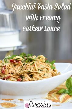 """Mix things up with a zoodle """"pasta"""" salad. These zucchini noodles combine creamy cashew sauce with the tang of sundries tomatoes and artichoke hearts."""
