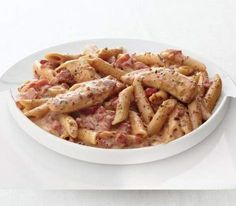 Creamy Parmesan and Sun-Dried Tomato Chicken Penne Recipe (hint: healthy swap: nix the half/half, use plain greek yogurt)