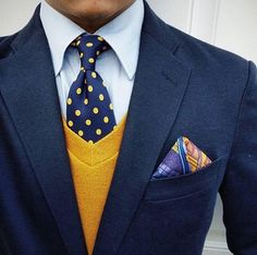 Close up by IGer @ thedetailedgent. The muted bronzed yellow sweater keeps the blue ensemble chic and not overpowering. The polka dot tie works well as a subtle yet bold pattern complimenting the patterned multi colored pocket square and bringing the color of the sweater and jacket together as one ensemble. Women, Men and Kids Outfit Ideas on our website at 7ootd.com #ootd #7ootd