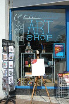 Natasha Durley window painting FLUX Art Shop opening, Bournemouth