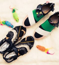 Designer Sneakers That Are Worth the Price: Embellished Black Dior Sneaker and Green, Black and White Emilio Pucci Sneakers | coveteur.com