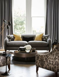 Sofa in Intaglio Weave upholstery and chairs in Tonquin Weave from the Wedgwood Home collection. Spot the Tonquin Print cushions as well! The dramatic black and gold colour scheme really makes this picture stand out.