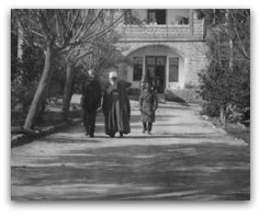 According to Saichiro Fujita, a Japanese Bahá'í who accompanied 'Abdu'l-Bahá on the Western portion of His journeys in America, and who later served in the Holy Land for many years, this photograph was taken in 1919 or 1920.    'Abdu'l-Bahá cultivated close relations with the leaders of all of the religious communities in Haifa. He paid a visit on Christmas Day to the Christian minister at this small church situated immediately behind His house, and asked Mr. Fujita to accompany Him.