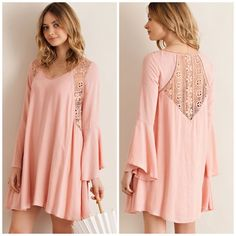Swing Tunic Cape Dress Feminine and flirty this dusty Peach swing baby doll tunic dress is available in S & M left only Lace detail along the back with flare sleeves . NWT please comment for personal listing Vivacouture Dresses Midi