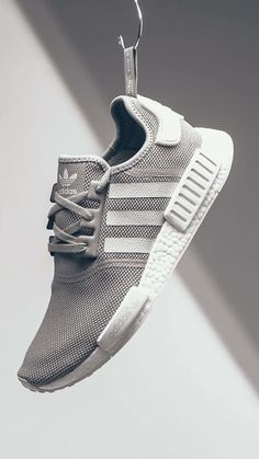 adidas Originals is back with a brand new adidas NMD in a tonal grey perfect for any occasion. The adidas has always been on the simple side of the NMD series thanks to the fact that the pair skips … Continue reading → Sneakers Addict, Nmd Sneakers, Grey Sneakers, Streetwear, Nike Air Force, Adidas Originals, Reebok, Look Adidas, Baskets