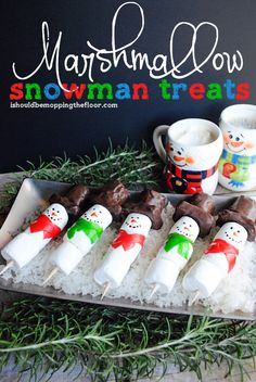 These Marshmallow Snowman Treats are easy to put together...would be a darling activity or snack at a kids' holiday party!