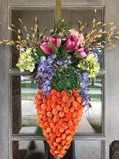 Everyone loved the Easter carrot made from wood shaving curls. I attached the carrot to the front of my market basket filled with Spring florals. So much fun! Easter 2018, Market Baskets, April 1st, Entertaining, Holiday Decorating, Decorating Ideas, Spring, Plants, Fun