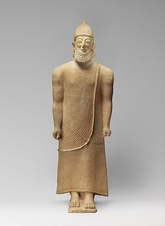 Limestone male figure - last quarter of the 6th century B.C.