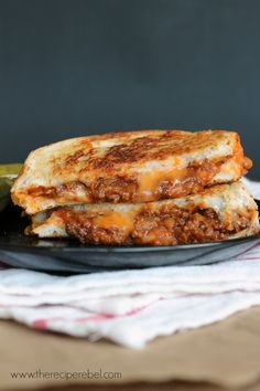 Sloppy Joe Grilled Cheese -- made with slow cooker sloppy joes (or use your favorite!). Perfect for a quick weeknight dinner!