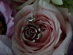 Silver,rose pendant filled with enamel