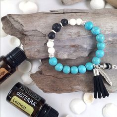 Turquoise and Black Lava Diffuser Bracelet Stretchy bracelet made with turquoise magnesite beads. Accented with diffusing lava beads. Simply rub a couple drops of your favorite essential oil into the lava. Does not come with essential oil. Quinn Sharp Designs  Jewelry Bracelets