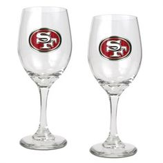 San Francisco 49ers wine glasses. This set of two 49ers wine glass set is decorated with a high-quality metal logo. Great with whites, reds or a mimosa! Perfect gift for that sophisticated sports fan!