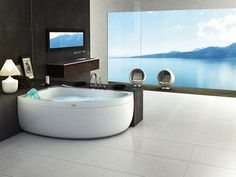 white-corner-jacuzzi-tub-feat-white-tiles-flooring-and-large-glass-windows.jpg…